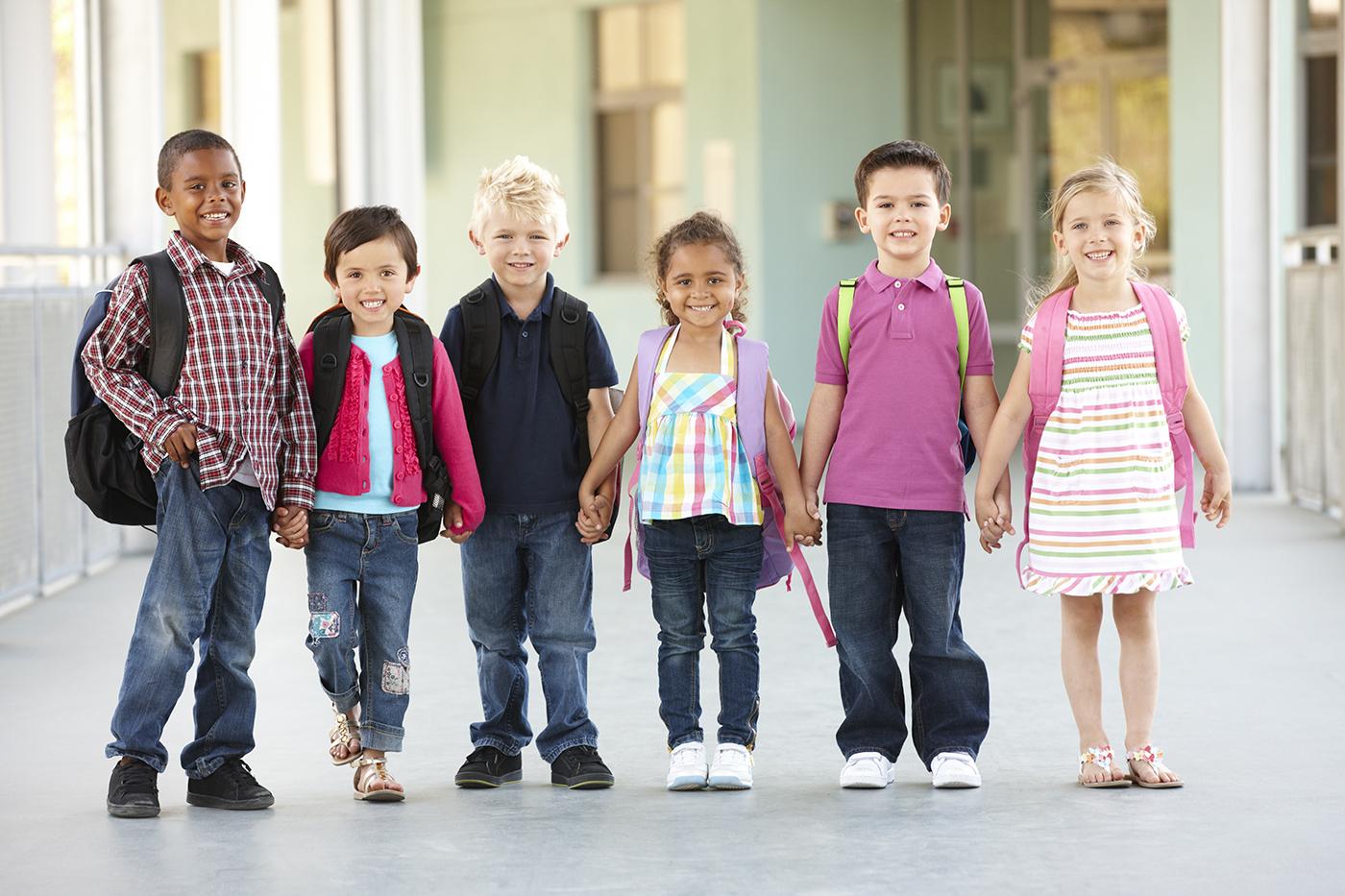 children at school holding hands