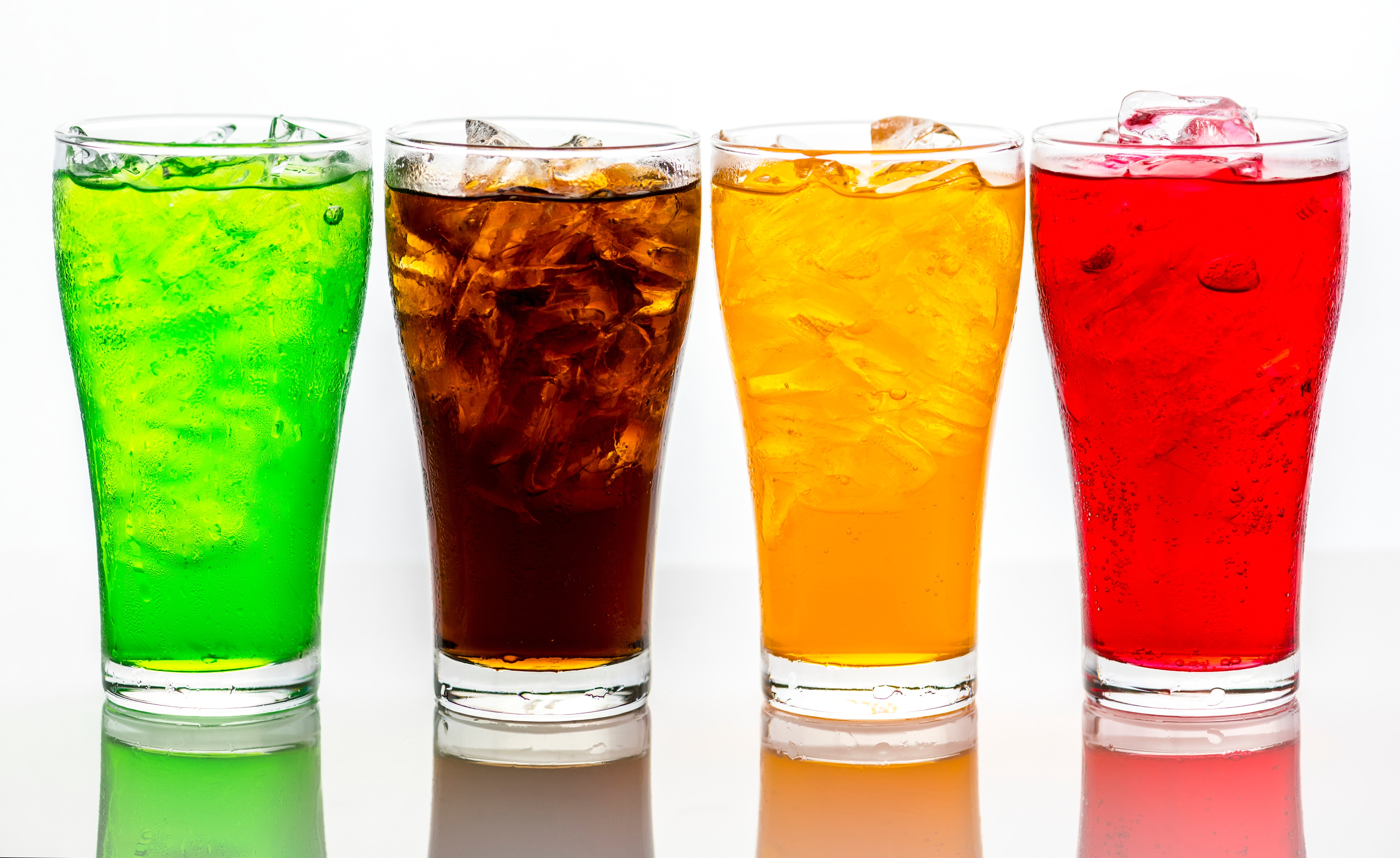 Colorful Carbonated Beverages in Glasses