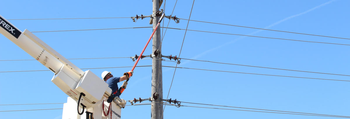 man fixing power transmission lines