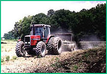 Description: tractor discing in sludge