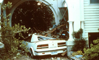 image of hurricane damage to a house and car