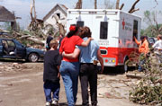 image of family in front of their damaged home after a hurricane