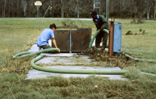 image of men working on a septic system