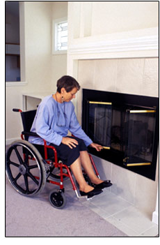 Woman at fireplace. - Photo credit - CDC/Richard Duncan 1994